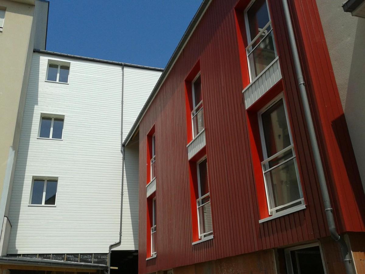 Réhabilitation d'un immeuble avec isolation extérieure et clin peint