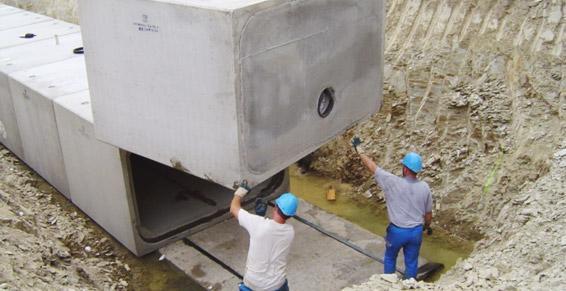 travaux publics - pose de ponts-cadres pour réserve d'eaux pluviales