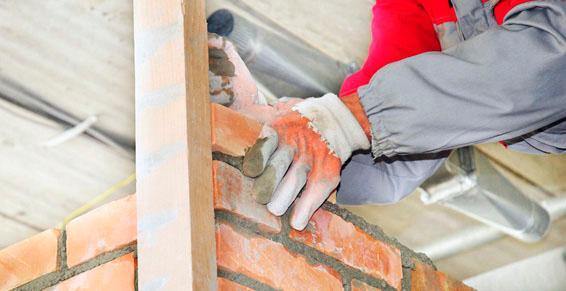 Maçonnerie entreprises - monter un mur de briques