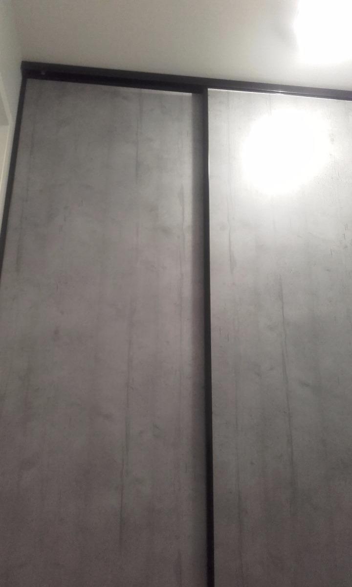 Installation d'une Façade coulissante Sogal remplissage effet béton co